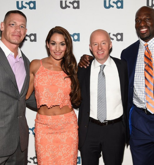"USA NETWORK EVENTS -- ""USA Network 2015 Upfront Press Event at The Rainbow Room in New York, NY on Tuesday, April 7, 2015"" -- Pictured: (l-r) John Cena, Nikki Bella ""WWE"", Chris McCumber, President, USA Network, Titus O'Neil ""WWE"" -- (Photo by: Mike Coppola/USA Network)"