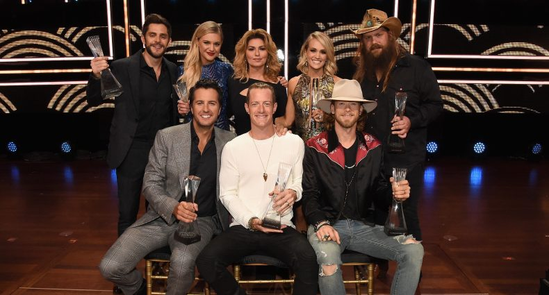 NASHVILLE, TN - OCTOBER 19: Honorees (back row, l-r) Thomas Rhett, Kelsea Ballerini, Shania Twain, Carrie Underwood, and Chris Stapleton; (front row, l-r) Luke Bryan and Florida Georgia Line's Tyler Hubbard and Brian Kelley pose for a photo during CMT Artists of the Year 2016 on October 19, 2016 in Nashville, Tennessee.  (Photo by Rick Diamond/Getty Images for CMT)