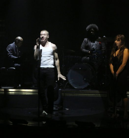 THE TONIGHT SHOW STARRING JIMMY FALLON -- Episode 0572 -- Pictured: (l-r) Musical guest Macklemore performs with Ariana Deboo and The Roots on November 16, 2016 -- (Photo by: Andrew Lipovsky/NBC)