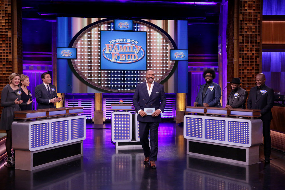 "THE TONIGHT SHOW STARRING JIMMY FALLON -- Episode 0584 -- Pictured: (l-r) Actress Greta Gerwig, actress Annette Bening, host Jimmy Fallon, television personality Steve Harvey, Ahmir ""Questlove"" Thompson, Tariq ""Black Thought"" Trotter, and James Poyser play ""Tonight Show Family Feud"" on December 05, 2016 -- (Photo by: Andrew Lipovsky/NBC)"