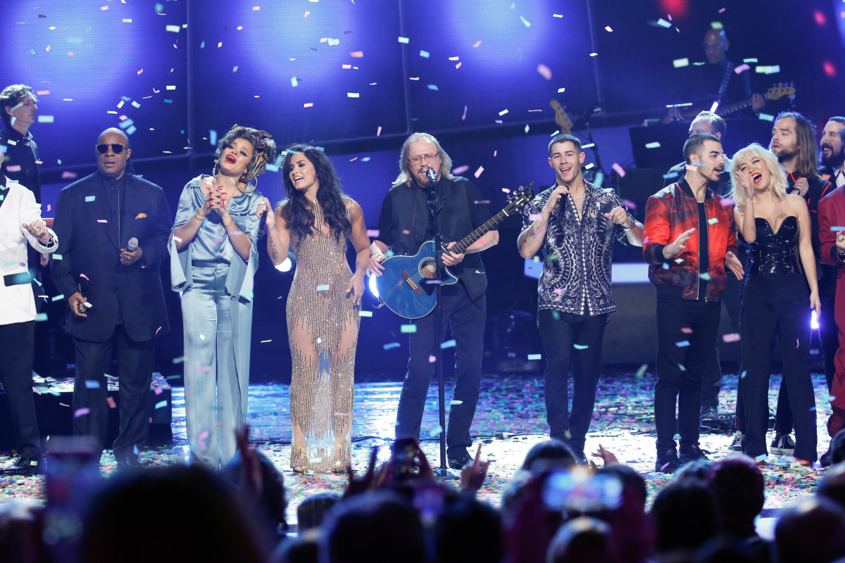 "Music stars Andra Day, Celine Dion, DNCE, Nick Jonas, Tori Kelly, Little Big Town, Demi Lovato, Katharine McPhee, Panic! at the Disco, Pentatonix, Ed Sheeran, Keith Urban, Kelsea Ballerini & Thomas Rhett, Jason Derulo & Tavares, John Legend & Stevie Wonder and Barry Gibb celebrate the Bee Gees' remarkable music catalog on, ""STAYIN' ALIVE: A GRAMMY® SALUTE TO THE MUSIC OF THE BEE GEES,"" Sunday, April, 16 (8:00-10:00 PM, ET/ PT) on the CBS Television Network. Pictured L-R: Stevie Wonder, Andra Day, Demi Lovato, Barry Gibb, Nick Jonas, and DNCE Photo: Monty Brinton/CBS ©2017 CBS Broadcasting, Inc. All Rights Reserved"