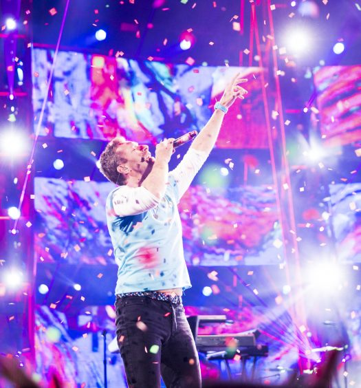 Chris Martin performing with Chainsmokers at iHearts [Andrew Swarz/iHeartRadio]