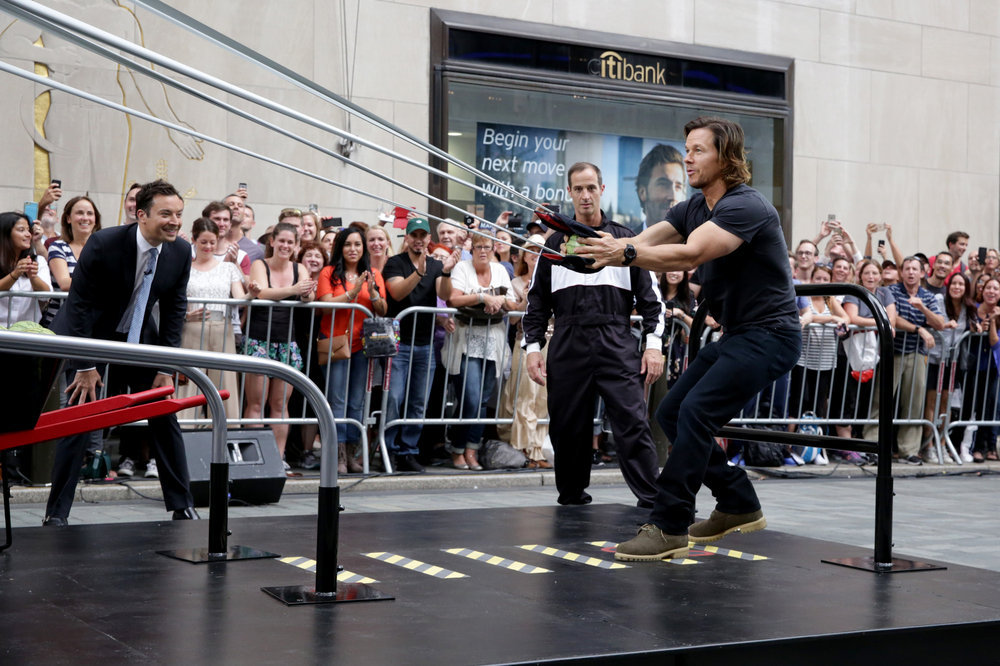 """THE TONIGHT SHOW STARRING JIMMY FALLON -- Episode 0537 -- Pictured: (l-r) Host Jimmy Fallon and actor Mark Wahlberg compete in a """"Giant Slingshot"""" competition on September 20, 2016 -- (Photo by: Andrew Lipovsky/NBC)"""