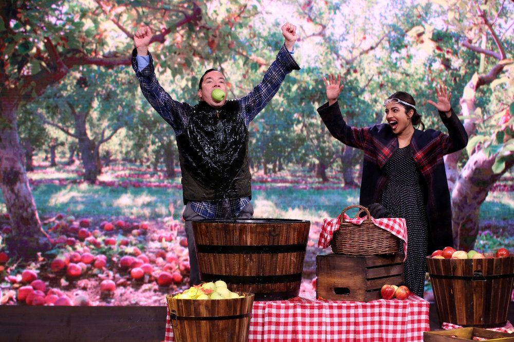 THE TONIGHT SHOW STARRING JIMMY FALLON -- Episode 0538 -- Pictured: (l-r) Actress Priyanka Chopra and Jimmy Fallon bob for apples on September 21, 2016 -- (Photo by: Andrew Lipovsky/NBC)