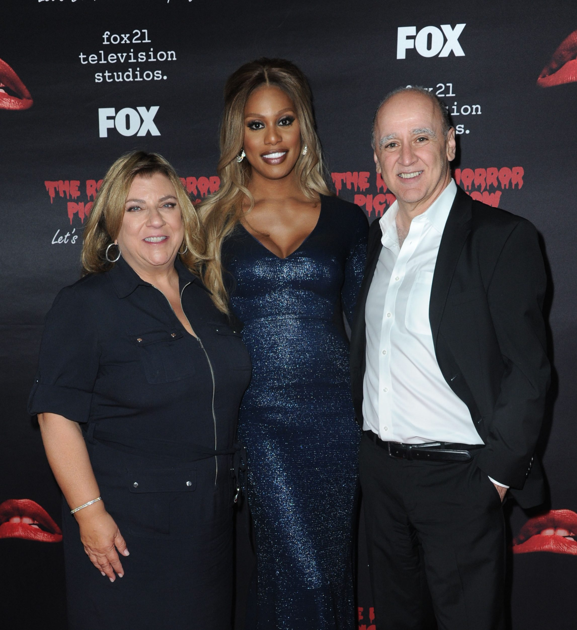 THE ROCKY HORROR PICTURE SHOW: Let's Do The Time Warp Again (and Transylvanians!): L-R: Executive Producer Gail Berman, cast member Laverne Cox and President, Entertainment, Fox Broadcasting Company David Madden arrive at THE ROCKY HORROR PICTURE SHOW: Let's Do The Time Warp Again (and Transylvanians!) premiere party red carpet at The Roxy on Thursday, Oct. 13, in Los Angeles, CA. THE ROCKY HORROR PICTURE SHOW: Let's Do The Time Warp Again (And Transylvanians!) premieres Thursday, Oct. 20 (8:00-10:00 PM ET/PT) on FOX. © 2016 FOX BROADCASTING CR: Rihard Shotwell/FOX