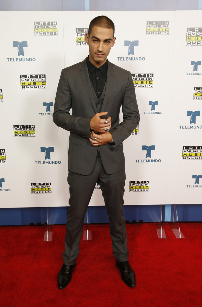 """2016 LATIN AMERICAN MUSIC AWARDS -- """"Press Room"""" -- Pictured: (l-r) Recording artist Michel Duval poses backstage at the 2016 Latin American Music Awards at the Dolby Theater in Los Angeles, CA on October 6, 2016 -- (Photo by: Jesse Grant/Telemundo)"""