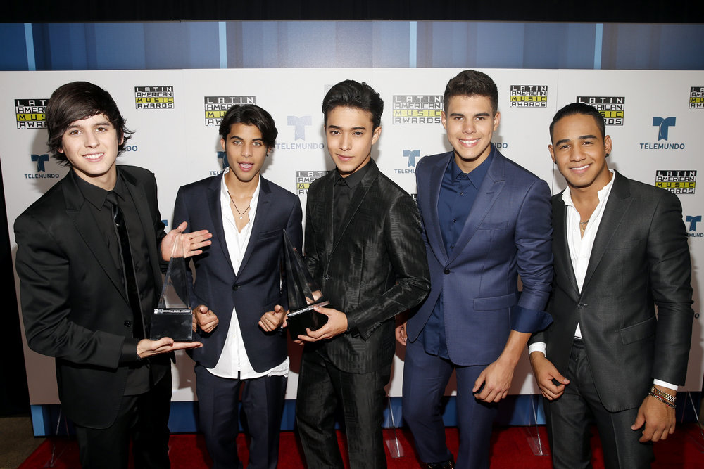 """2016 LATIN AMERICAN MUSIC AWARDS -- """"Press Room"""" -- Pictured: Musical group CNCO pose backstage at the 2016 Latin American Music Awards at the Dolby Theater in Los Angeles, CA on October 6, 2016 -- (Photo by: Jesse Grant/Telemundo)"""