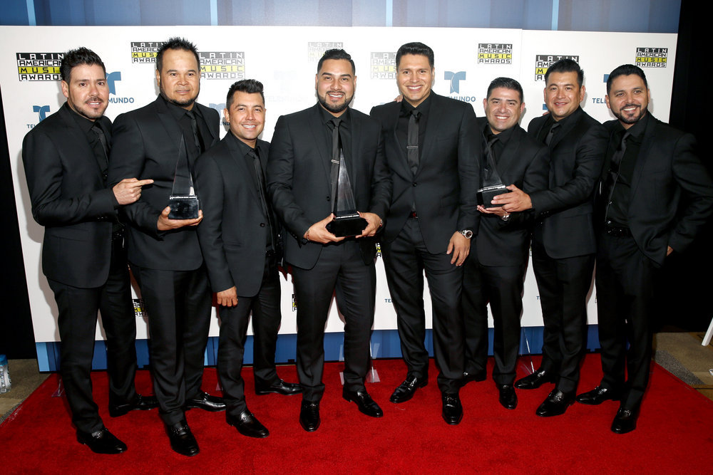 """2016 LATIN AMERICAN MUSIC AWARDS -- """"Press Room"""" -- Pictured: Musical group Banda Sinaloense MS de Sergio Lizarraga pose backstage at the 2016 Latin American Music Awards at the Dolby Theater in Los Angeles, CA on October 6, 2016 -- (Photo by: Jesse Grant/Telemundo)"""