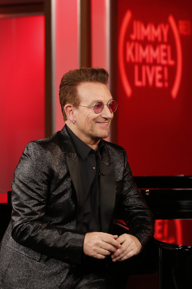 """JIMMY KIMMEL LIVE - On TUESDAY, NOVEMBER 22, ABC's """"Jimmy Kimmel Live"""" is once again joining forces with Bono and (RED) for a special episode of the late-night program in an effort to raise awareness and money to help the fight against AIDS. Jimmy and Bono will be joined by Julia Roberts, Channing Tatum, Kristen Bell, DJ Khaled, Neil Patrick Harris, Halsey, The Killers and more. (ABC/Randy Holmes) BONO"""