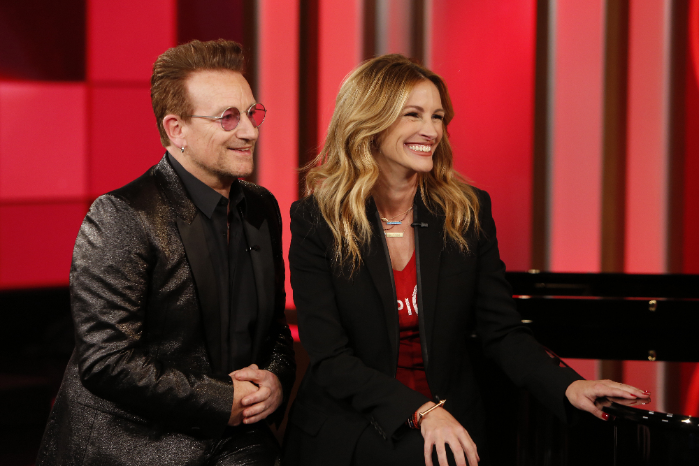 """JIMMY KIMMEL LIVE - On TUESDAY, NOVEMBER 22, ABC's """"Jimmy Kimmel Live"""" is once again joining forces with Bono and (RED) for a special episode of the late-night program in an effort to raise awareness and money to help the fight against AIDS. Jimmy and Bono will be joined by Julia Roberts, Channing Tatum, Kristen Bell, DJ Khaled, Neil Patrick Harris, Halsey, The Killers and more. (ABC/Randy Holmes) BONO, JULIA ROBERTS"""