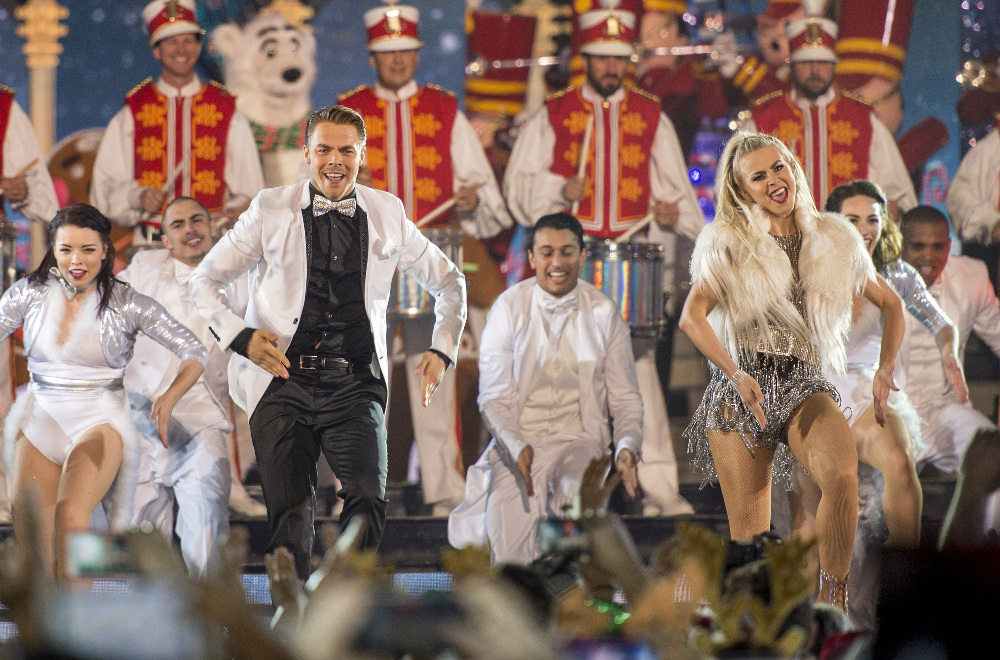 "THE WONDERFUL WORLD OF DISNEY: MAGICAL HOLIDAY CELEBRATION - ""The Wonderful World of Disney: Magical Holiday Celebration"" premieres on THANKSGIVING, THURSDAY, NOVEMBER 24 (8:00-10:00 p.m. EST) on the ABC Television Network and on the ABC app. Join Emmy Award-winners Julianne and Derek Hough as they host the magical two-hour special from the Walt Disney World Resort. They join ""Descendants 2"" star Sofia Carson to kick off the holiday season in a way only Disney can, showcasing extraordinary music performances, special appearances and some unforgettable Disney magic moments. (DISNEY/Kent Phillips) DEREK HOUGH, JULIANNE HOUGH"