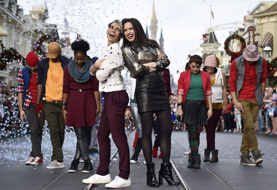 """DISNEY CHANNEL – Talent from Disney Channel were at the Walt Disney World Resort in Orlando, Florida during the taping for """"Disney Parks Presents: A Descendants Magical Holiday Celebration"""" that will air Friday, November 25 on Disney Channel. (Disney Channel/Mark Ashman) CAMERON BOYCE, SOFIA CARSON"""