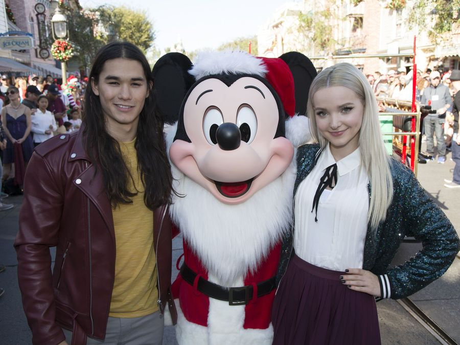 """DESCENDANTS 2 – """"Descendants 2"""" stars Dove Cameron and Booboo Stewart perform """"Jolly to the Core,"""" a holiday rendition of the hit song """"Rotten to the Core"""" during """"Disney Parks Presents: A Descendants Magical Holiday Celebration"""" at Disneyland Park in Anaheim, California. The Descendants holiday telecast airs Nov. 25 on Disney Channel. (Disney Channel/Scott Brinegar) BOOBOO STEWART, MICKEY MOUSE, DOVE CAMERON"""