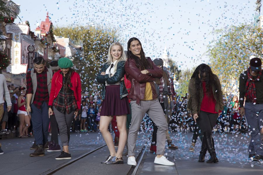 """DESCENDANTS 2 – """"Descendants 2"""" stars Dove Cameron and Booboo Stewart perform """"Jolly to the Core,"""" a holiday rendition of the hit song """"Rotten to the Core"""" during """"Disney Parks Presents: A Descendants Magical Holiday Celebration"""" at Disneyland Park in Anaheim, California. The Descendants holiday telecast airs Nov. 25 on Disney Channel. (Disney Channel/Scott Brinegar) DOVE CAMERON, BOOBOO STEWART"""