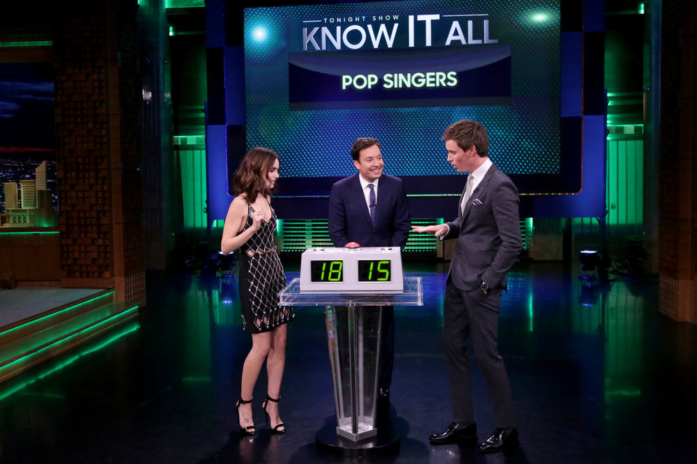 """THE TONIGHT SHOW STARRING JIMMY FALLON -- Episode 0567 -- Pictured: (l-r) Actress Lily Collins, host Jimmy Fallon, and actor Eddie Redmayne play """"Know It All"""" on November 9, 2016 -- (Photo by: Andrew Lipovsky/NBC)"""