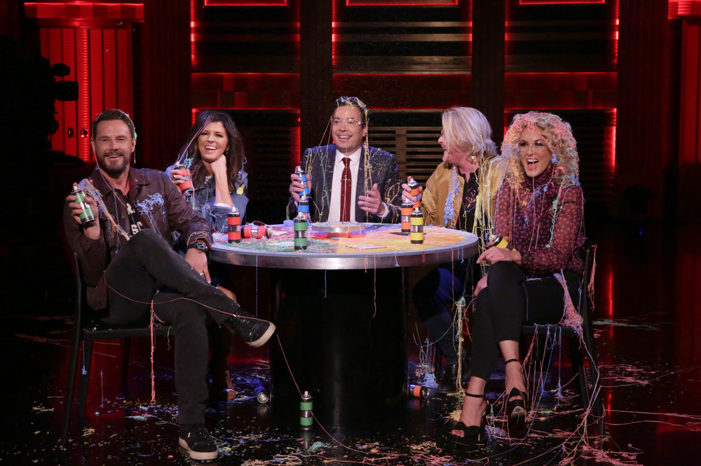 """THE TONIGHT SHOW STARRING JIMMY FALLON -- Episode 0570 -- Pictured: (l-r) Karen Fairchild, Jimi Westbrook, Phillip Sweet, and Kimberly Schlapman of musical guest Little Big Town play """"Stranger Strings"""" with host Jimmy Fallon (center) on November 14, 2016 -- (Photo by: Andrew Lipovsky/NBC)"""