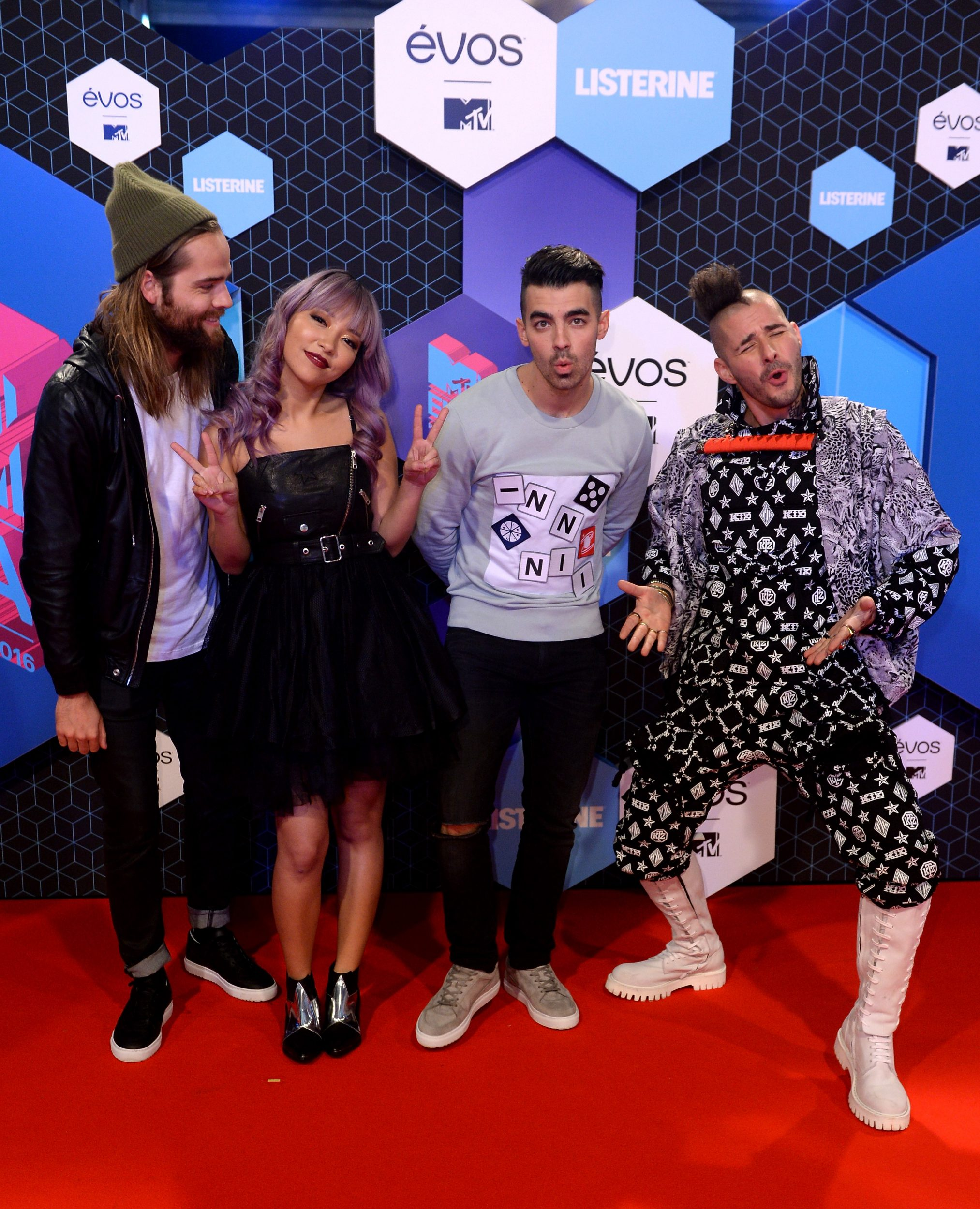 ROTTERDAM, NETHERLANDS - NOVEMBER 06: (EXCLUSIVE COVERAGE) (L-R) Jack Lawless, JinJoo Lee, Joe Jonas and Cole Whittle of DNCE attend the MTV Europe Music Awards 2016 on November 6, 2016 in Rotterdam, Netherlands. (Photo by Anthony Harvey/Getty Images for MTV) *** Local Caption *** Joe Jonas;Jack Lawless;JinJoo Lee;Cole Whittle