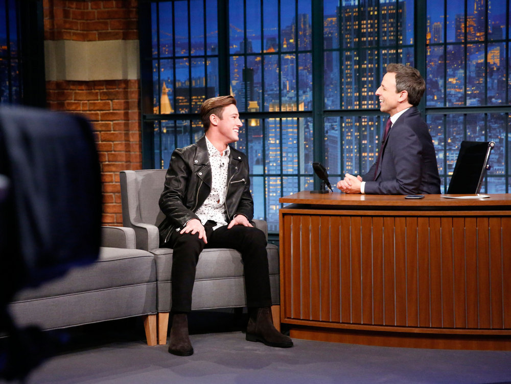 LATE NIGHT WITH SETH MEYERS -- Episode 467 -- Pictured: (l-r) Internet personality Cameron Dallas during an interview with host Seth Meyers on December 22, 2016 -- (Photo by: Lloyd Bishop/NBC)