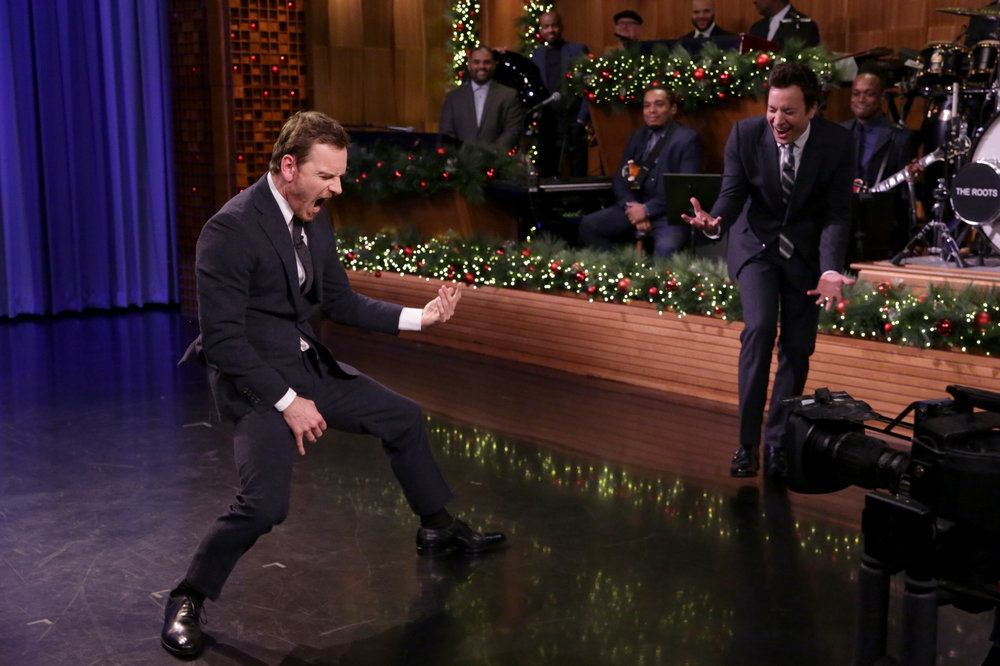 THE TONIGHT SHOW STARRING JIMMY FALLON -- Episode 0590 -- Pictured: (l-r) Actor Michael Fassbender and host Jimmy Fallon have an Air Guitar Battle on December 13, 2016 -- (Photo by: Andrew Lipovsky/NBC)