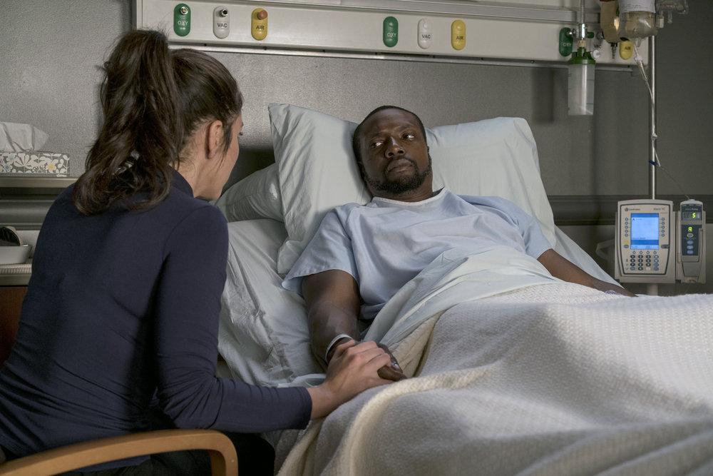 "BLINDSPOT -- ""Nor I, Nigel, AKA Leg In Iron"" Episode 210 -- Pictured: (l-r) Audrey Esparza as Tasha Zapata, Rob Brown as Edgar Reade -- (Photo by: David Giesbrecht/NBC)"