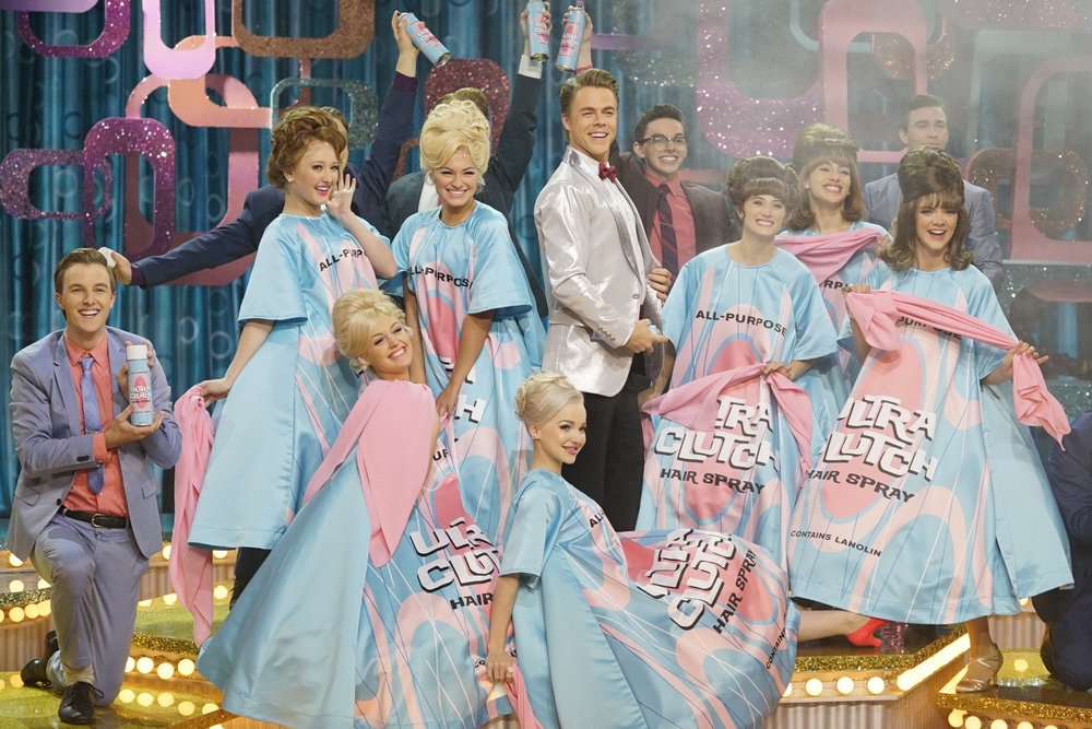 HAIRSPRAY LIVE! -- Pictured: (l-r) Dove Cameron as Amber Von Tussle, Derek Hough as Corny Collins -- (Photo by: Paul Drinkwater/NBC)