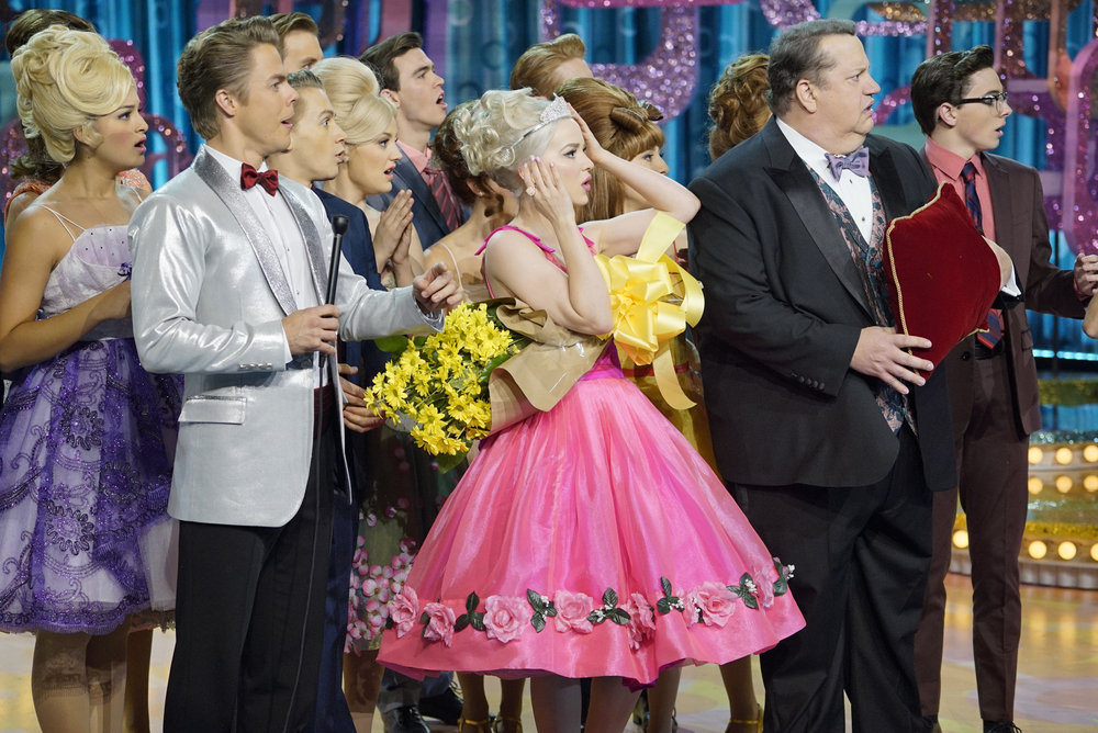 HAIRSPRAY LIVE! -- Pictured: (l-r) Derek Hough as Corny Collins, Dove Cameron as Amber Von Tussle, Paul Vogt as Mr. Spritzer -- (Photo by: Paul Drinkwater/NBC)