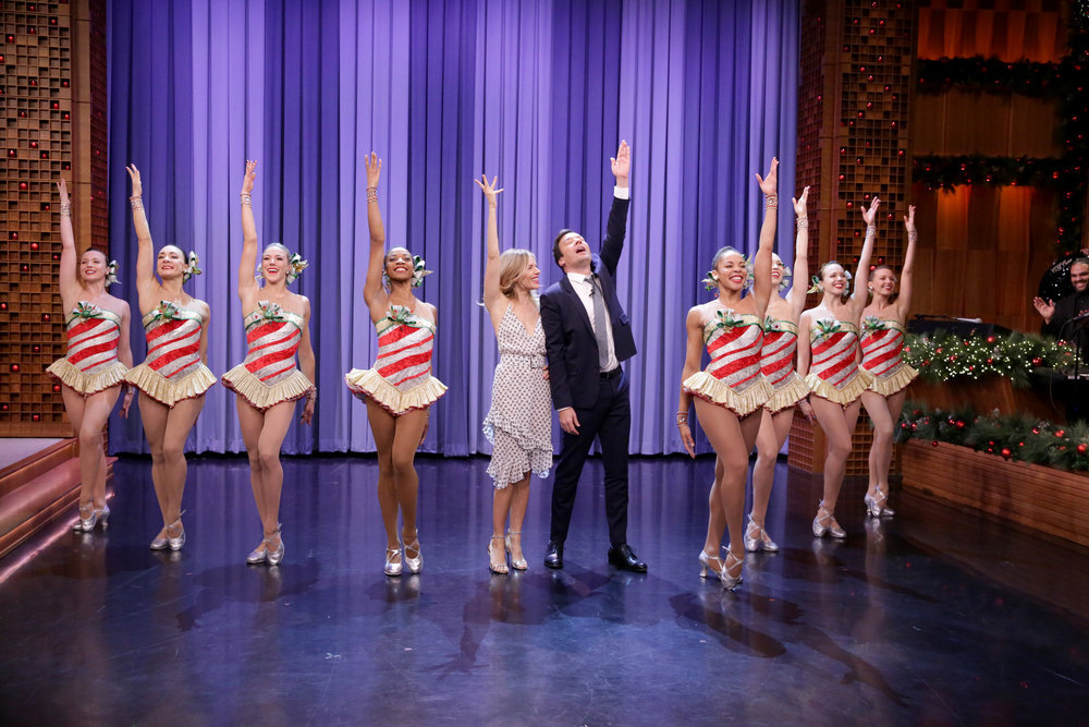 THE TONIGHT SHOW STARRING JIMMY FALLON -- Episode 0592 -- Pictured: (l-r) Actress Sienna Miller and host Jimmy Fallon dance with The Rockettes on December 15, 2016 -- (Photo by: Andrew Lipovsky/NBC)