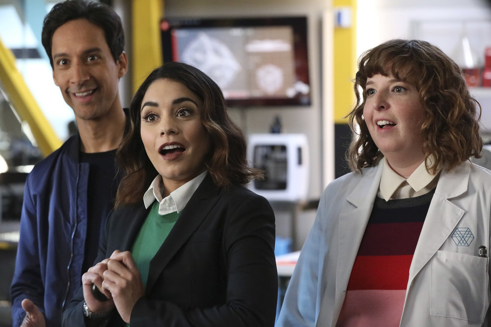 """POWERLESS -- """"Wayne or Lose"""" Episode 102 -- Pictured: (l-r) Danny Pudi as Teddy, Vanessa Hudgens as Emily, Jenni Pierson as Wendy -- (Photo by: Evans Vestal Ward/NBC)"""