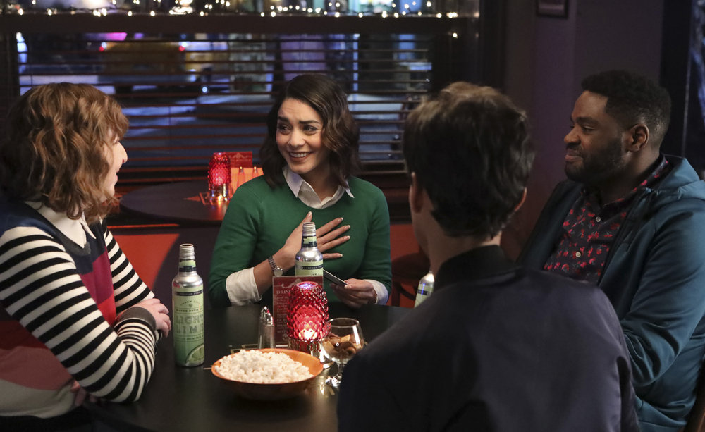 """POWERLESS -- """"Wayne or Lose"""" Episode 102 -- Pictured: (l-r) Jennie Pierson as Wendy, Vanessa Hudgens as Emily, Ron Funches as Ron, Danny Puid as Teddy -- (Photo by: Evans Vestal Ward/NBC)"""