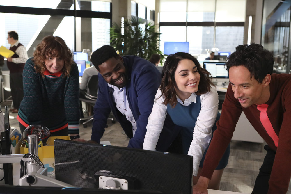 """POWERLESS -- """"Wayne Dream Team"""" Episode 103 -- Pictured: (l-r) Jennie Pierson as Wendy, Ron Funches as Ron, Vanessa Hudgens as Emily, Danny Pudi as Teddy -- (Photo by: Evans Vestal Ward/Warner Bros/NBC)"""