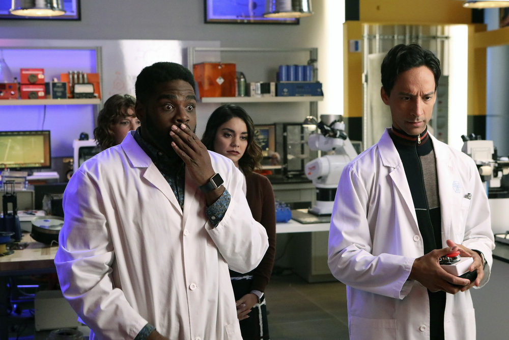 """POWERLESS -- """"Wayne Dream Team"""" Episode 103 -- Pictured: (l-r) Jennie Pierson as Wendy, ROn Funches as Ron, Vanessa Hudgens as Emily,Danny Pudi as Teddy -- (Photo by: Evans Vestal Ward/Warner Bros/NBC)"""