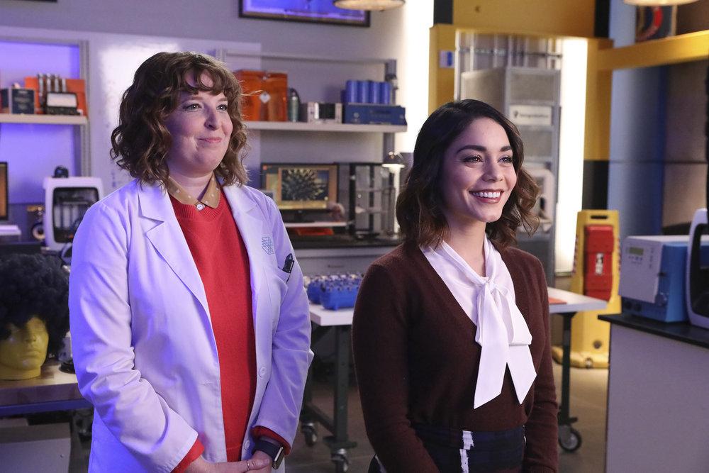 "POWERLESS -- ""Wayne Dream Team"" Episode 103 -- Pictured: (l-r) Jennie Pierson as Wendy, Vanessa Hudgens as Emily -- (Photo by: Evans Vestal Ward/Warner Bros/NBC)"