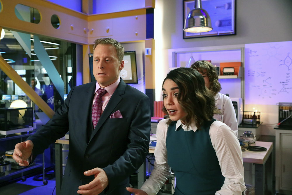"POWERLESS -- ""Wayne Dream Team"" Episode 103 -- Pictured: (l-r) Alan Tudyk as Van, Vanessa Hudgens as Emily -- (Photo by: Evans Vestal Ward/Warner Bros/NBC)"
