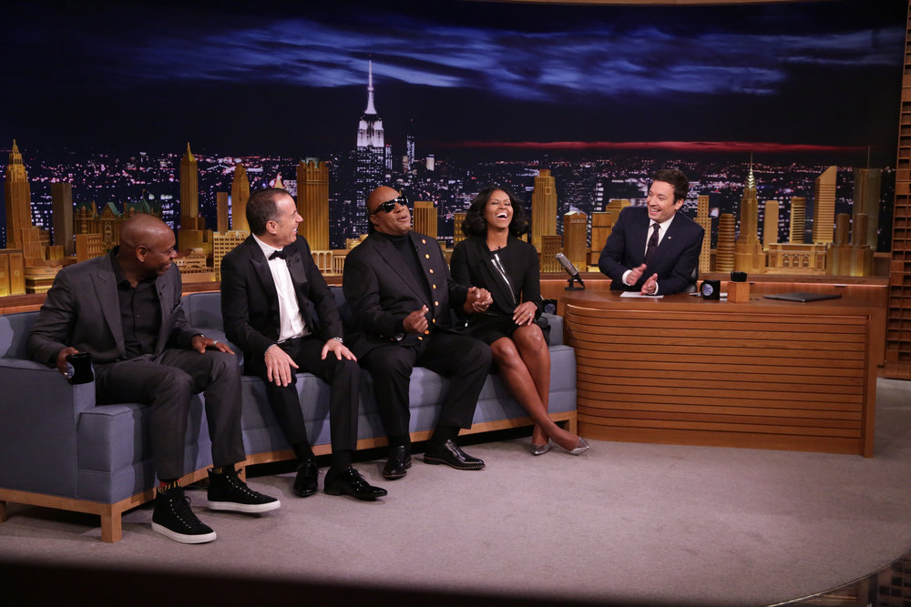 THE TONIGHT SHOW STARRING JIMMY FALLON -- Episode 0600 -- Pictured: (l-r) Comedian Dave Chappelle, comedian Jerry Seinfeld, musical guest Stevie Wonder, First Lady Michelle Obama, and host Jimmy Fallon converse on January 11, 2017 -- (Photo by: Andrew Lipovsky/NBC)