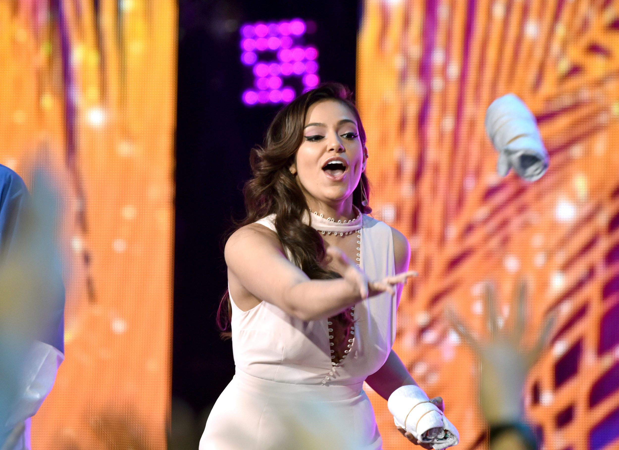 LOS ANGELES, CA - MARCH 11:  Internet personality Bethany Mota tosses a T-shirt onstage at Nickelodeon's 2017 Kids' Choice Awards at USC Galen Center on March 11, 2017 in Los Angeles, California.  (Photo by Frazer Harrison/KCA2017/Getty Images for Nickelodeon - Issued to Media by Nickelodeon)