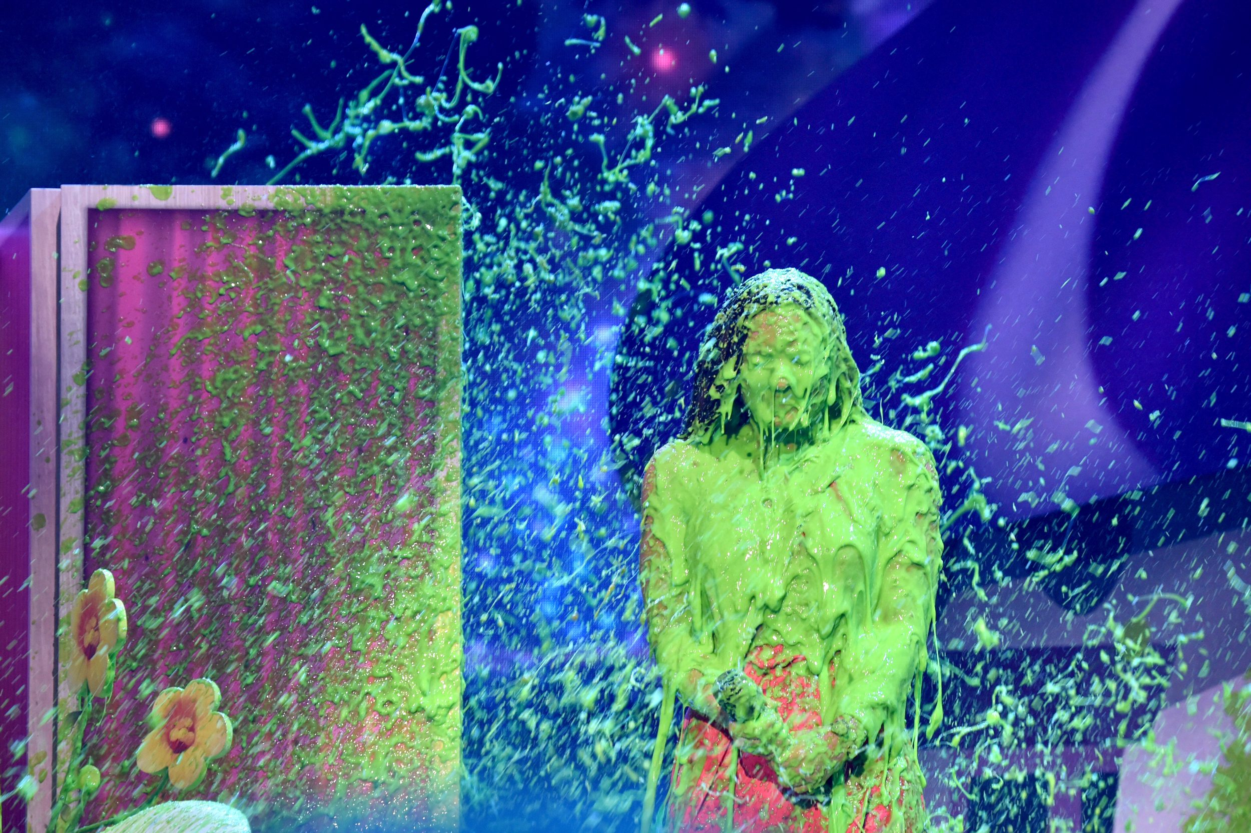 LOS ANGELES, CA - MARCH 11:  Singer Demi Lovato gets slimed onstage at Nickelodeon's 2017 Kids' Choice Awards at USC Galen Center on March 11, 2017 in Los Angeles, California.  (Photo by Frazer Harrison/KCA2017/Getty Images for Nickelodeon)