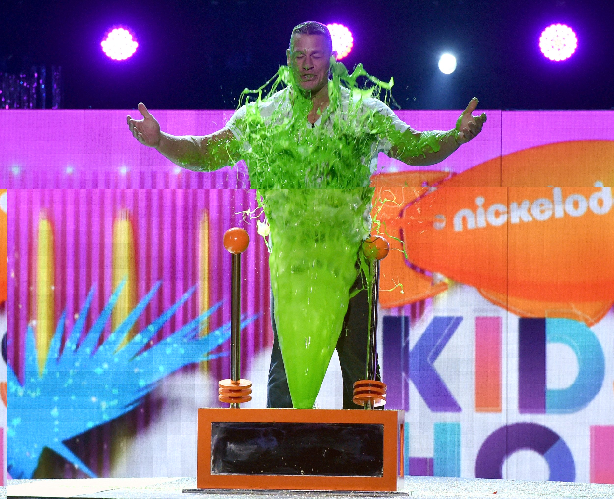 LOS ANGELES, CA - MARCH 11:  Host John Cena gets slimed onstage at Nickelodeon's 2017 Kids' Choice Awards at USC Galen Center on March 11, 2017 in Los Angeles, California.  (Photo by Kevin Winter/Getty Images - Issued to Media by Nickelodeon)