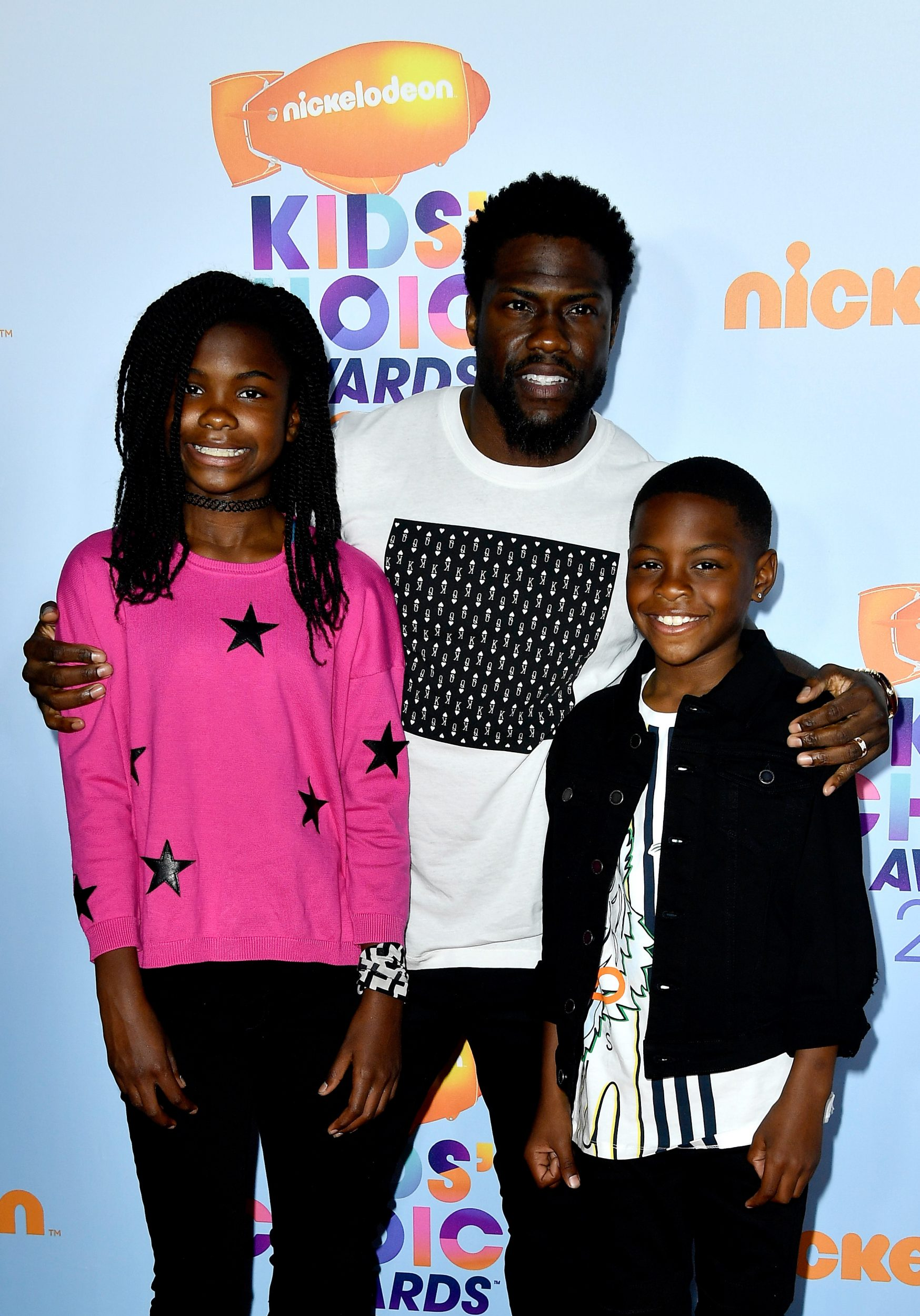 LOS ANGELES, CA - MARCH 11:  Actor Kevin Hart (C) with Heaven Hart and Hendrix Hart at Nickelodeon's 2017 Kids' Choice Awards at USC Galen Center on March 11, 2017 in Los Angeles, California.  (Photo by Frazer Harrison/Getty Images - Issued to Media by Nickelodeon)