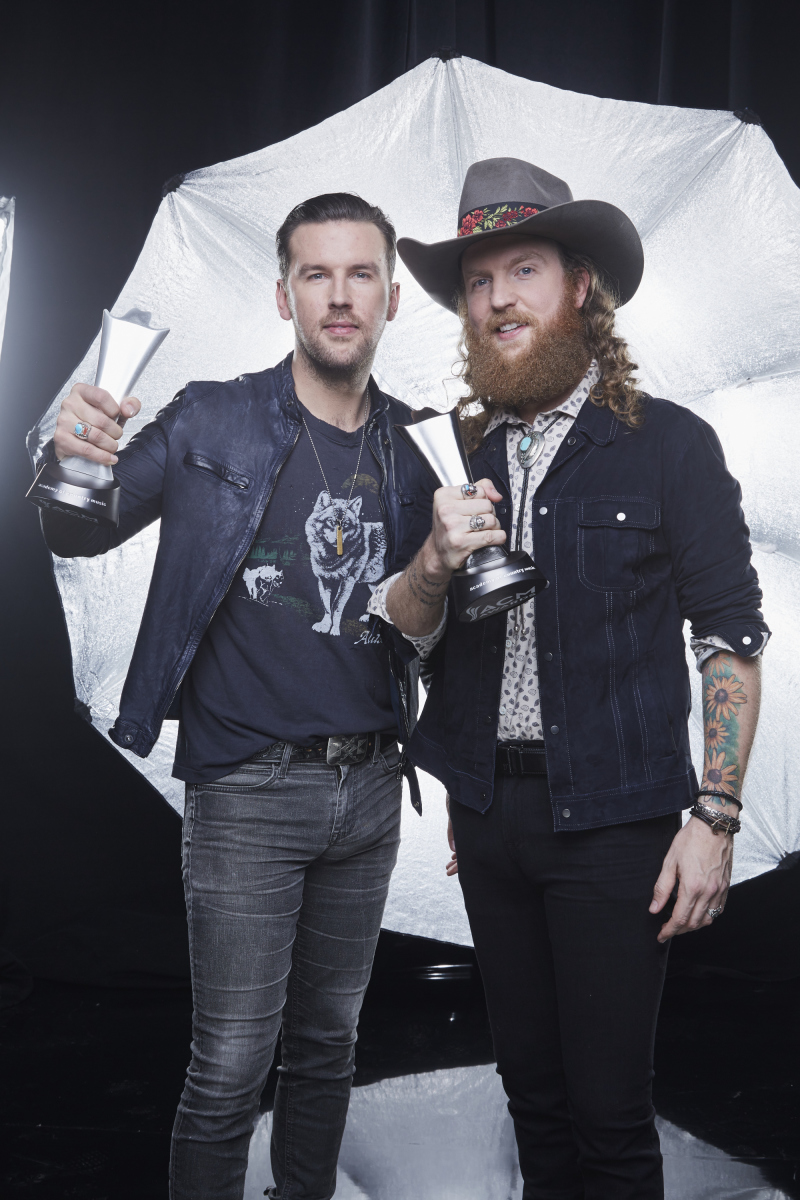 Brothers Osborne pose for a photograph at the photo booth THE 52ND ACADEMY OF COUNTRY MUSIC AWARDS®, broadcast LIVE from T-Mobile Arena in Las Vegas Sunday, April 2 (8:00-11:00 PM, live ET/delayed PT) on the CBS Television Network. Photo: Monty Brinton/CBS ©2017 CBS Broadcasting, Inc. All Rights Reserved