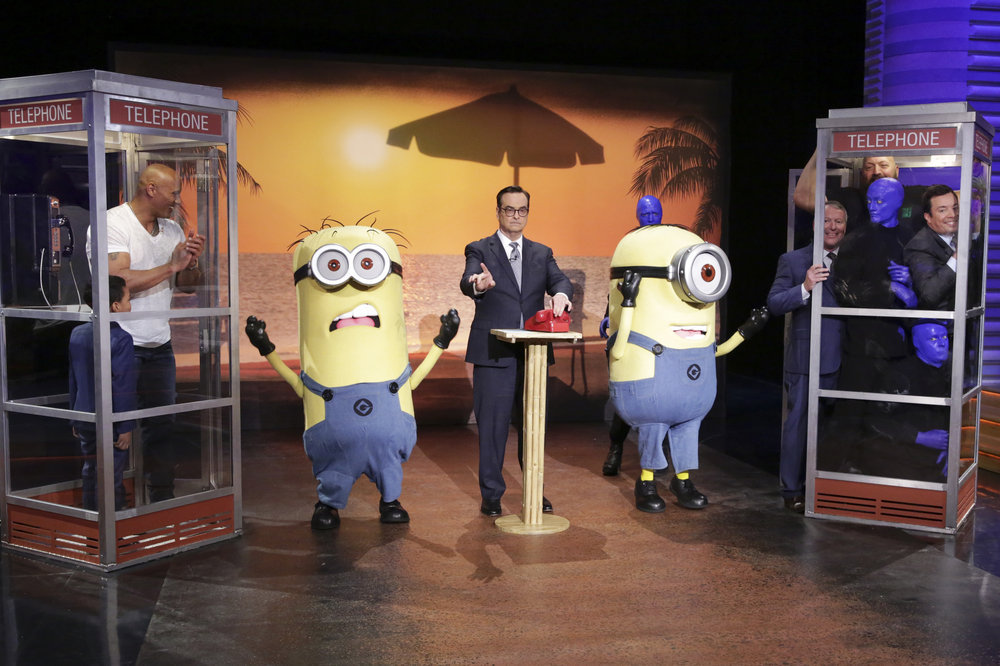 "THE TONIGHT SHOW STARRING JIMMY FALLON -- Episode 0653 -- Pictured: (l-r) Kid Genius Romanieo Dolphin Jr., actor Dwayne Johnson, Minions, announcer Steve Higgins, Blue Man Group, WWE Superstar Big Show, and host Jimmy Fallon during ""Phone Booth""on April 5, 2017 -- (Photo by: Andrew Lipovsky/NBC)"